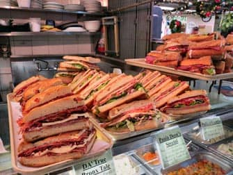 sandwiches at the italian market with the Bronx tour New York